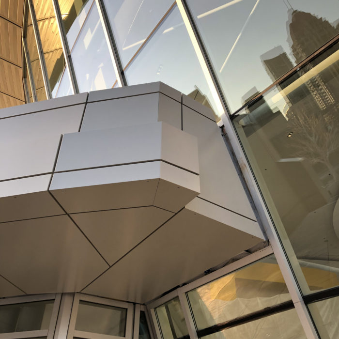 Square One aluminum panels at the front of the building