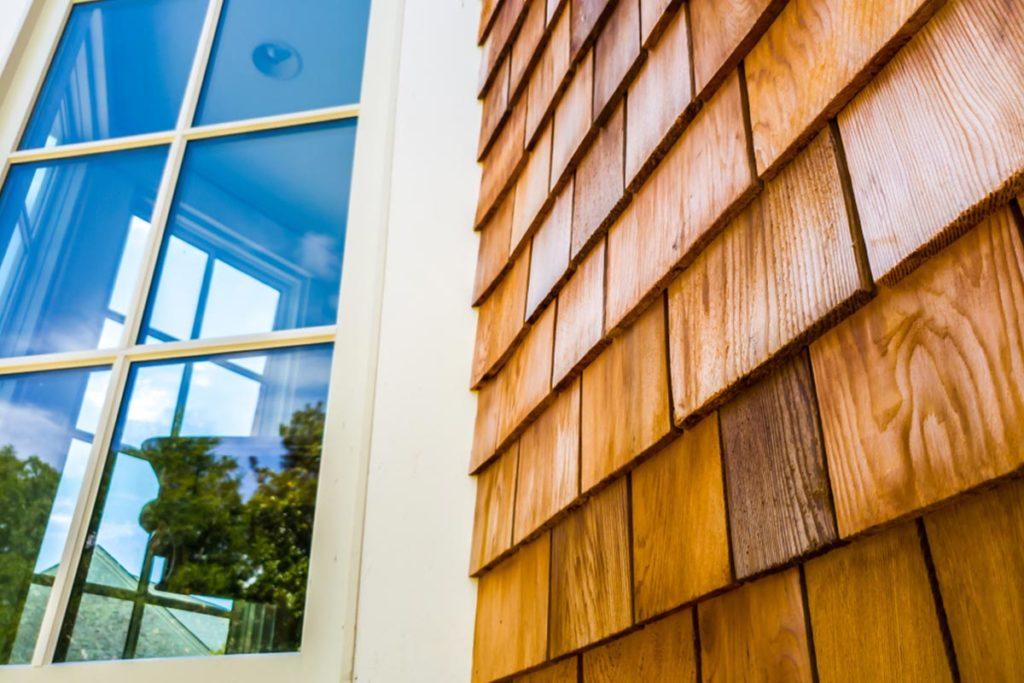Cedar shake siding panels replaced on new house